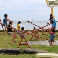 Living up to their name: Children in the village of Libertad on Siargao Island, Surigao del Norte province, in the Philippines make good use of playground equipment purchased and installed by JOYFUL. | JOYFUL