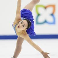 Raising her profile: Wakaba Higuchi, 13,  seen performing to 'Piano Concerto in F' during Sunday's free skate, earned a third-place finish at nationals. | KYODO