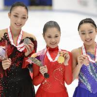 Top achievement: Satoko Miyahara (center), Rika Hongo (left) and Wakaba Higuchi placed first, second and third, respectively, at the All-Japan Championships on Sunday in Nagano. | KYODO