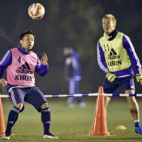 Japan players put faith in Aguirre