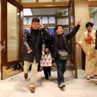 Shoppers rush into a Tokyo department store on Jan. 2 to buy 'lucky bags' containing items worth three times their price tags to celebrate a new year of business. | AFP-JIJI