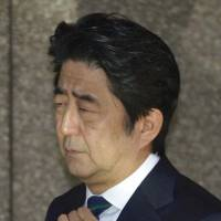 Prime Minister Shinzo Abe leaves a TV studio Sunday morning after commenting on the veracity purportedly released by the Islamic State.  | KYODO