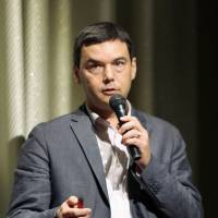 Popular French economist Thomas Piketty speaks at a symposium in Tokyo Thursday evening. | KYODO