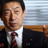 Health, Labor and Welfare Minister Yasuhisa Shiozaki gestures during an interview in Tokyo on Wednesday.   BLOOMBERG
