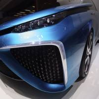 A visitor examines a Toyota Motor Corp. Mirai prototype at the Geneva International Motor Show in Switzerland last March.   BLOOMBERG