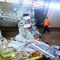 AirAsia jet's alarms 'screaming' before crash: investigator