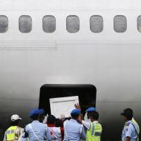 Indonesian soldiers and rescue personnel prepare to transport the coffin of a passenger of AirAsia Flight QZ8501 at Iskandar air base in Pangkalan Bun on Tuesday.   REUTERS