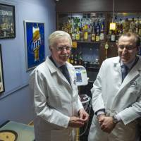 Dr. George Koob (left), director of the National Institute on Alcohol Abuse and Alcoholism, and NIAAA scientist Dr. Lorenzo Leggio pose in a research lab designed as a bar in the National Institutes of Health's hospital in Bethesda, Maryland, on Dec. 19. | AP