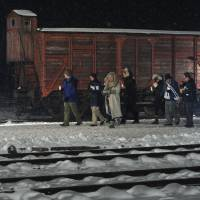 On Auschwitz anniversary, survivors solemn, leader warns Jews are again targets
