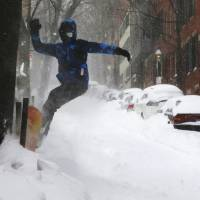 Blizzard barrels into Boston but brunt bypasses Big Apple