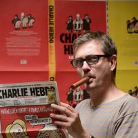 A handout photo taken last October in Paris and released Wednesday by French magazine L'amateur de cigares shows French satirical weekly Charlie Hebdo's publisher, known only as Charb. He was among 12 people slain by gunmen who attacked his weekly Wednesday. | AFP-JIJI
