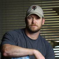 Chris Kyle, a former U.S. Navy SEAL and author of the book 'American Sniper,' poses in Midlothian, Texas, in April 2012. | AP