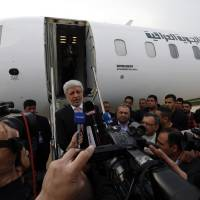 Iraqi Transport Minister Bayan Jabor speaks to the media during a news conference Tuesday at Baghdad International airport. Airlines from at least three countries suspended flights to Baghdad on Tuesday after bullets hit an airplane operated by budget carrier Dubai Aviation Corp., known as flydubai, as it was landing at Baghdad airport. | REUTERS