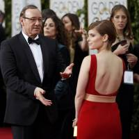 Actors Kevin Spacey and Kate Mara arrive at the 72nd Golden Globe Awards in Beverly Hills, California, on Sunday. | REUTERS