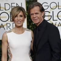 Actors Felicity Huffman and WIlliam H. Macy arrive at the 72nd Golden Globe Awards Sunday. | REUTERS