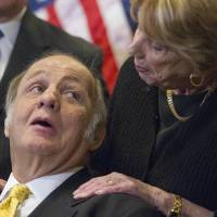Former White House press secretary James Brady looks at his wife, Sarah, during a news conference on Capitol Hill on March 30, 2011, the 30th anniversary of the shooting that left him paralyzed. | AP