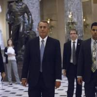 House Speaker John Boehner of Ohio walks from the House chamber on Capitol Hill Wednesday as lawmakers vote to fund the Department of Homeland Security and curb President Barack Obama's executive actions on immigration. | AP