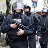 French police prepare to storm a kosher supermarket in eastern Paris on Friday during a nationwide manhunt to find the perpetrators of Wednesday's murderous rampage at the offices of satirical newspaper Charlie Hebdo. | REUTERS