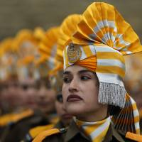Indian policewomen take part in a rehearsal for the Republic Day parade in Srinagar on Saturday. India celebrated its annual Republic Day on Monday. In talks with U.S. President Barack Obama a day earlier, Indian Prime Minister Narendra Modi signaled a shift in his government's thinking on climate change.   REUTERS