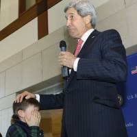 Kerry says he's going to France to give 'a big hug to Paris'