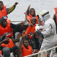 Malta places 90 rescued boat migrants in Ebola quarantine after hearing of dead thrown overboard