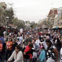 The crowd leaves after watching a parade Thursday at Disneyland in Anaheim, California. A major measles outbreak traced to Disneyland has brought criticism down on the small but vocal movement among parents to opt out of vaccinations for their children. | AP