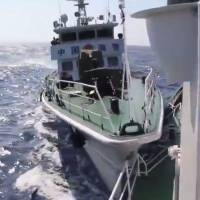 A Chinese maritime patrol ship rams a Vietnamese vessel in the South China Sea, in this grab from a video of the incident provided by the Vietnam Coast Guard. | VIETNAM COAST GUARD