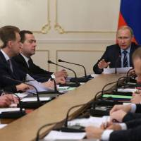 Russian President Vladimir Putin meets with his Cabinet, which includes Deputy Prime Minister Dmitry Kozak (from left), Deputy Prime Minister Olga Golodets, First Deputy Prime Minister Igor Shuvalov and Prime Minister Dmitry Medvedev, at the Novo-Ogaryovo residence outside Moscow on Wednesday. | AP