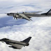 A British Typhoon fighter jet intercepts a Russian Bear bomber over the North Atlantic in 2008. Moscow has been sending the nuclear-capable aircraft to buzz European airspace, but the flights are increasingly disruptive. | U.K. DEFENSE MINISTRY
