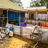 An Ebola virus decontamination zone at the Hastings treatment clinic in Freetown is empty Friday. With the outbreak weakening in West Africa, Sierra Leone eased restrictions on movement and commercial activity Friday even as the president warned that the fight against the deadly disease is not yet over. | AP