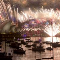 Sydney snubs terror fears as pyrotechnic spectacular leads global New Year's celebrations; Hong Kong dazzles