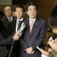 Prime Minister Shinzo Abe speaks to reporters at his office in Tokyo on Wednesday after discussing the hostage crisis with his Cabinet ministers. | AP