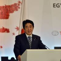 Prime Minister Shinzo Abe delivers a speech at a business and investment conference in Cairo on Saturday during his official visit to Egypt. | AFP-JIJI