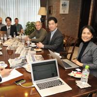 The Japan Times Media Advisory Board members deliver their observations and recommendations to executive members of the newspaper at its headquarters in Minato Ward, Tokyo, on Nov. 19. | YOSHIAKI MIURA