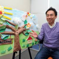 Michiro Morishita, a division manager for the nonprofit organization Florence, discusses day care services for disabled children during an interview at the NPO's office in Tokyo on Dec. 16. | YOSHIAKI MIURA