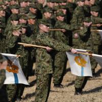Members of the Ground Self-Defense Forces' 1st Airborne Brigade take part in an annual new year military drill at Camp Narashino in Funabashi, Chiba Prefecture, east of Tokyo on Sunday. | REUTERS
