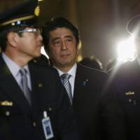 Prime Minister Shinzo Abe walks to attend the opening day of the Diet session in Tokyo on Monday. | REUTERS