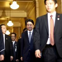 Prime Minister Shinzo Abe leaves the Diet on Tuesday after answering questions about the Islamic State hostage crisis. | REUTERS