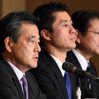 Katsuya Okada (left), seeking the top post in the Democratic Party of Japan, speaks as his two opponents, Goshi Hosono (center) and Akira Nagatsuma, look on at a news conference at the Foreign Correspondents' Club of Japan in Tokyo on Thursday. | AFP-JIJI