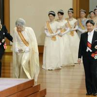 Emperor Akihito and Empress Michiko ascend the stage at their annual New Year's greeting ceremony Thursday morning.