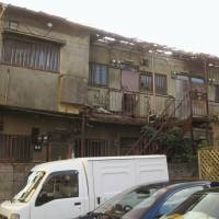 A file photo from December 2013 shows a derelict apartment building in Ota Ward, Tokyo, which was demolished by the local authorities after standing unoccupied for about a decade. | KYODO