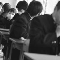 Children chat in a classroom in Kesennuma, Miyagi Prefecture, at the start of the school year in April 2011. Online bullying is often hard for adults to detect and can escalate to serious levels. | AP