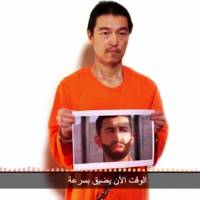 Screenshot of the second video message from the Islamic State group to the Japanese government, in which a man claiming to be Kenji Goto warns that there are only 24 hours left to save   his life and even less time for a Jordanian air force pilot Muath al-Kasasbeh, who is also being held by the group.