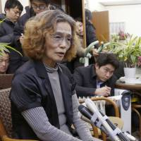 Junko Ishido, the mother of hostage Kenji Goto, speaks to the media at her home in Koganei, west Tokyo, late Wednesday. | AP