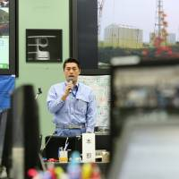 As environment and nuclear disasters minister, Goshi Hosono was heavily involved in recovery efforts following the Fukushima No. 1 plant disaster. He is seen here on May 26, 2012, addressing Tokyo Electric Power Co. staff at the plant's emergency operations center.  | BLOOMBERG