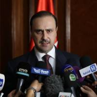 Jordanian government spokesman Mohammad al-Momani speaks to the media in Amman on Thursday. | AFP