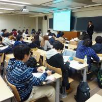 A company employment official speaks to students during a job seminar at Nihon University in Tokyo in November. | KYODO