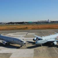 A U.S. Navy P-8A Poseidon (left) parks next to a Kawasaki P-1 maritime patrol aircraft of the Maritime Self-Defense Force at Atsugi air base in Kanagawa Prefecture in November. | U.S. NAVY/REUTERS