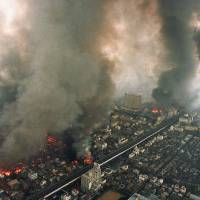 Multiple fires rage in central Kobe on Jan. 17, 1995, after the Hanshin region was heavily damaged by a magnitude-7.3 earthquake. | KYODO