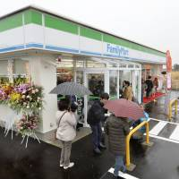 A FamilyMart outlet reopens Friday in the town of Naraha, Fukushima Prefecture. It is the first convenience store to resume business in the evacuation zone since the triple core meltdowns of March 2011. | KYODO